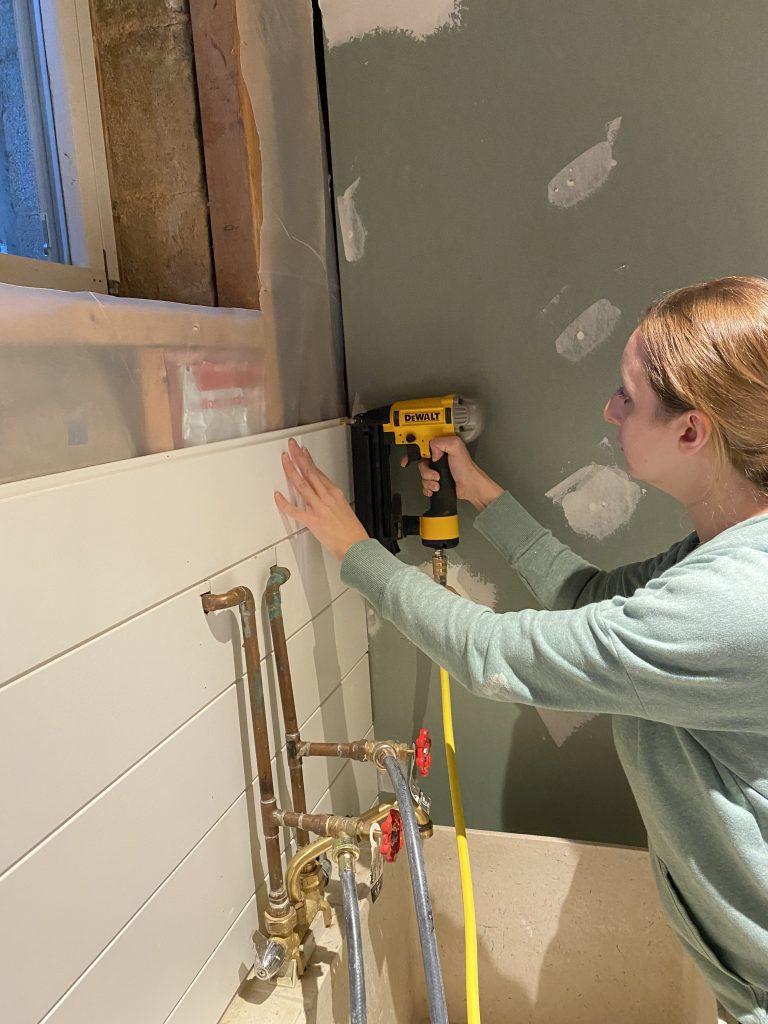 Using a nail gun to install shiplap