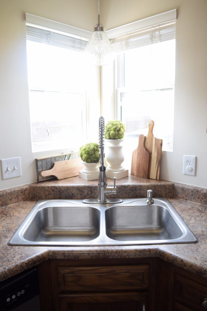 Change the Faucet to Remodel Your Kitchen On A Tight Budget