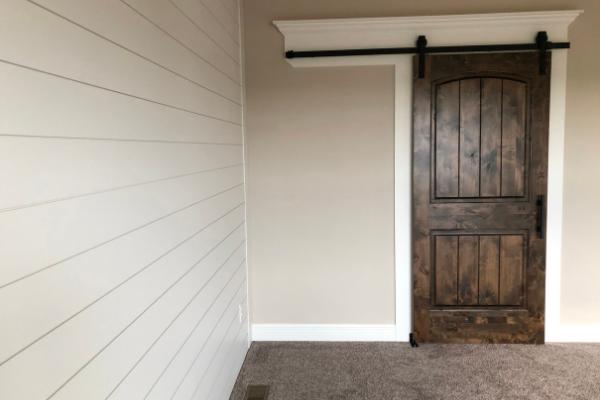 shiplap walls make a room look longer