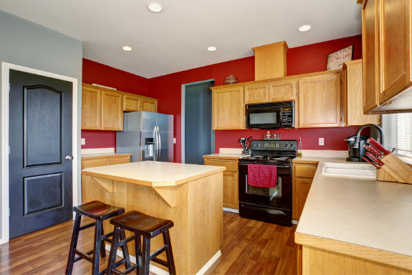 red kitchen walls wood cabinets